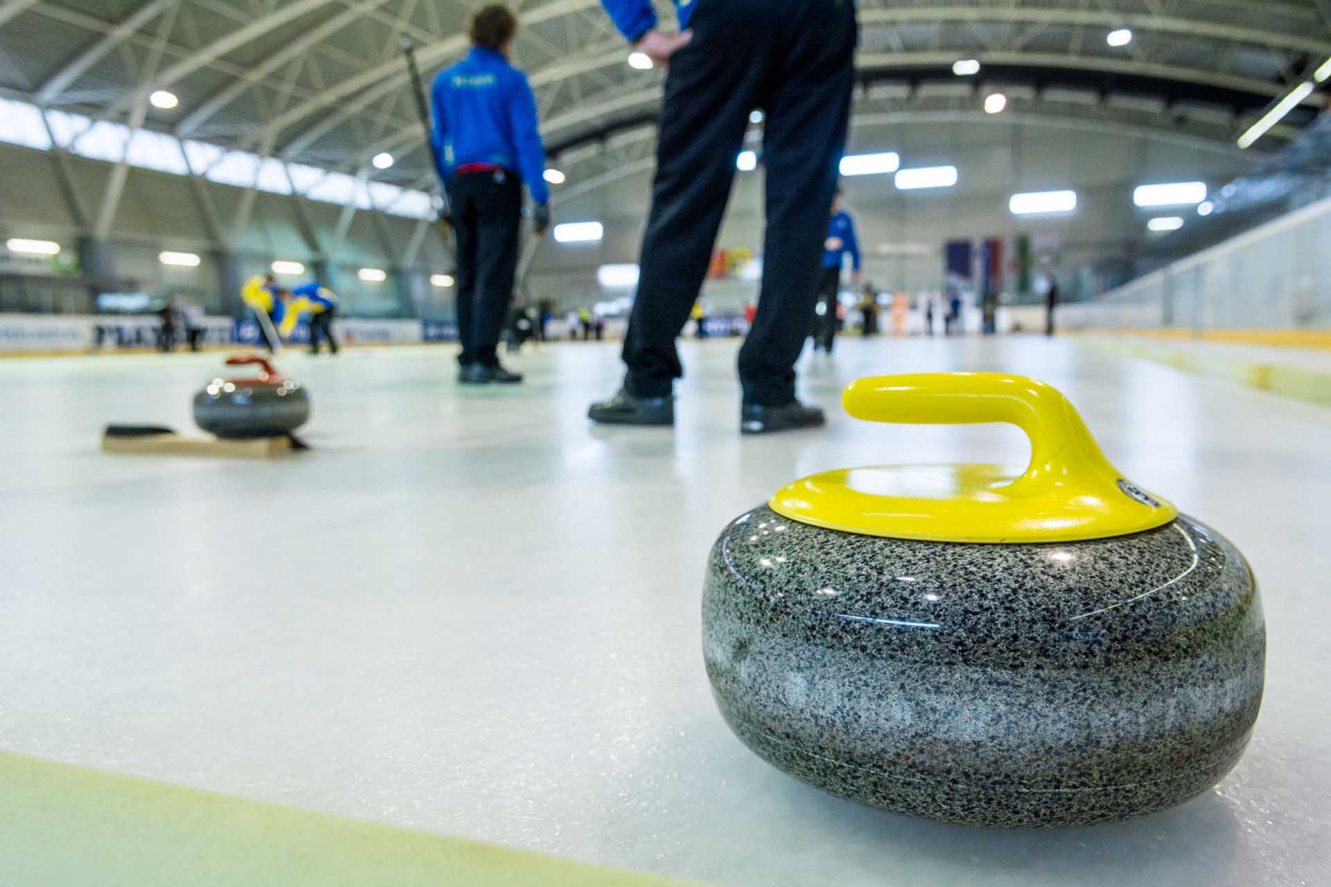Curling stone on a game sheet
